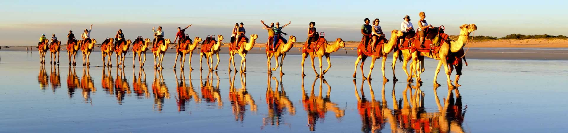 Leisure Travel Slider – Group Riding Camels